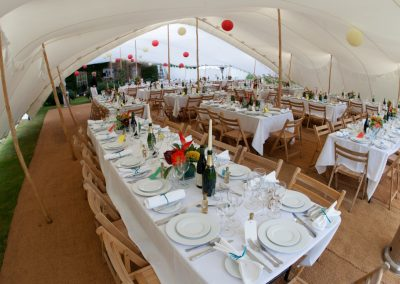 Inside a white wedding stretch tent