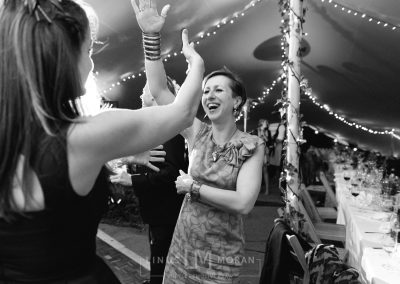 Fairy lights and dancing guests under a chino stretch tent