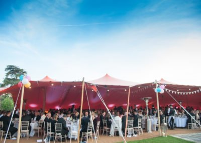 Stonegate foundation formal dining under orange stretch tent