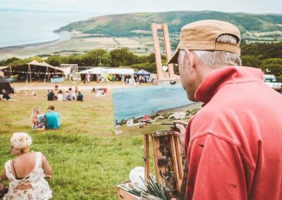 A painter at a coastal festival. Credit matt stephens painter peter brown
