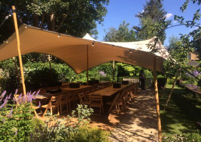 A white stertch tent for garden dining