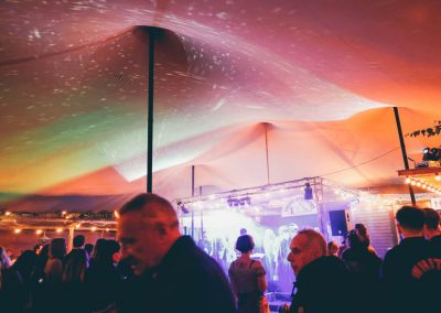 Chino stretch tent illuminated with uplighters and disco lights