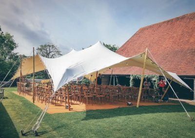 White stretch tent with coconut matting