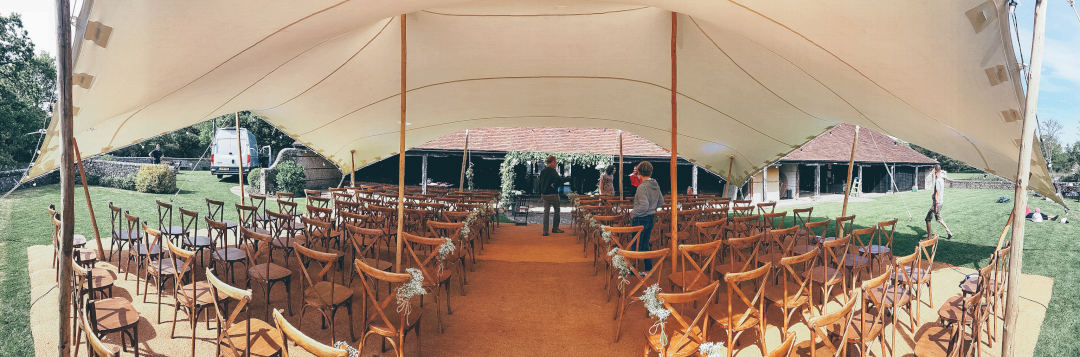wedding ceremony under stretch tent