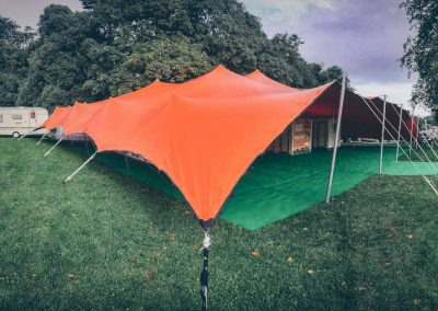 Orange stretch tent with sides down