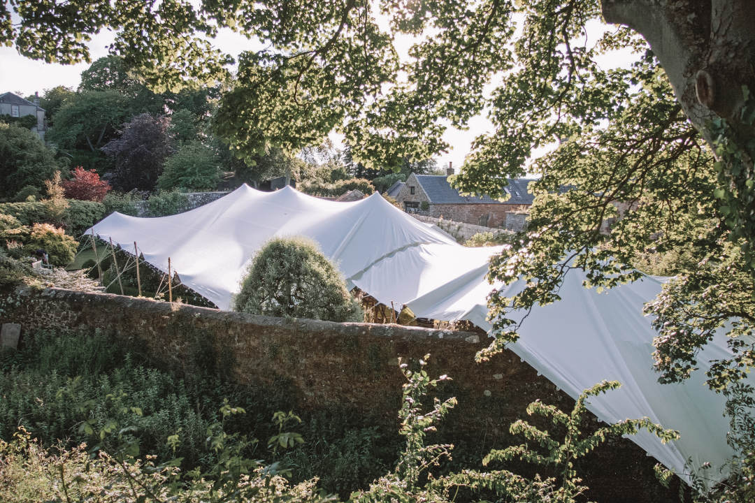White stretch tents over a wall