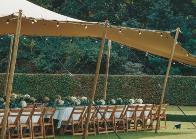 Chino Stretch tent with rustic furniture in Battersea Park, London