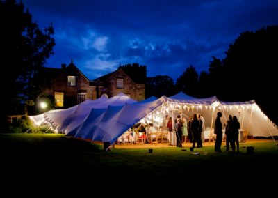 Wedding reception at dusk with festoons