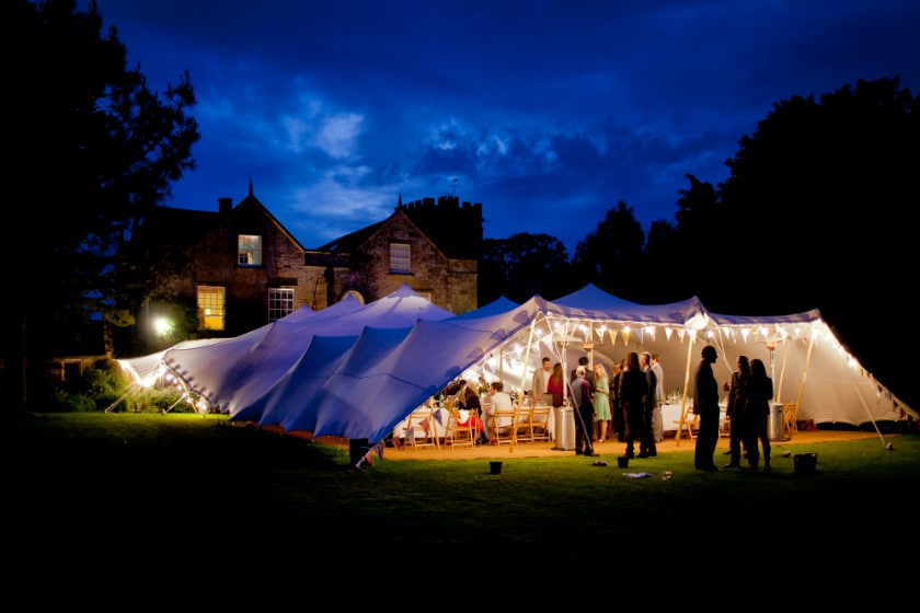 white stretch tent with festoons
