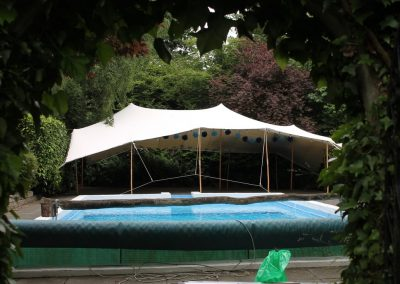 White Stretch tent for a pool party in Croyden