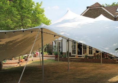 Stretch tent in a Guildford Garden