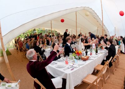 Speeches under a white Stretch Tent
