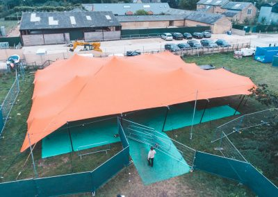 When nature calls orange stretch tent. Drone image by James Ranken