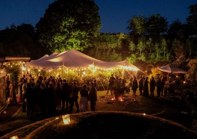 White stretch tent at a wedding reception evening with festoons