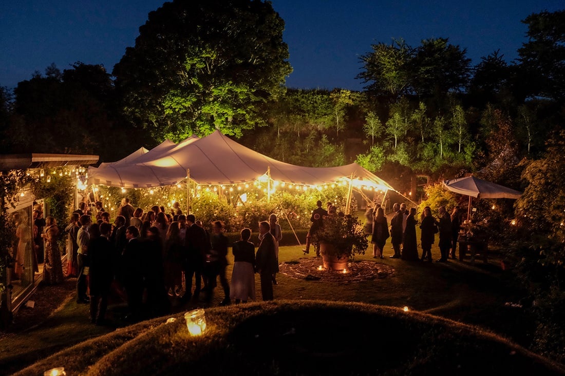 white stretch tent night with festoons