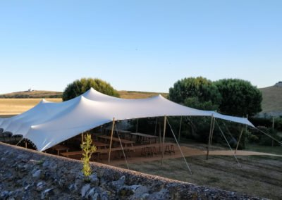 White stretch tent in a meadow