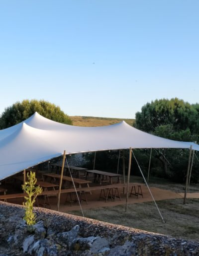white stretch tent in meadow