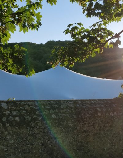 white stretch tent over wall