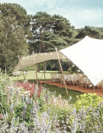 Soft floral white stretch tent rig